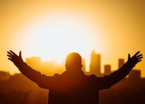 Picture of Man with arms in sky praising God